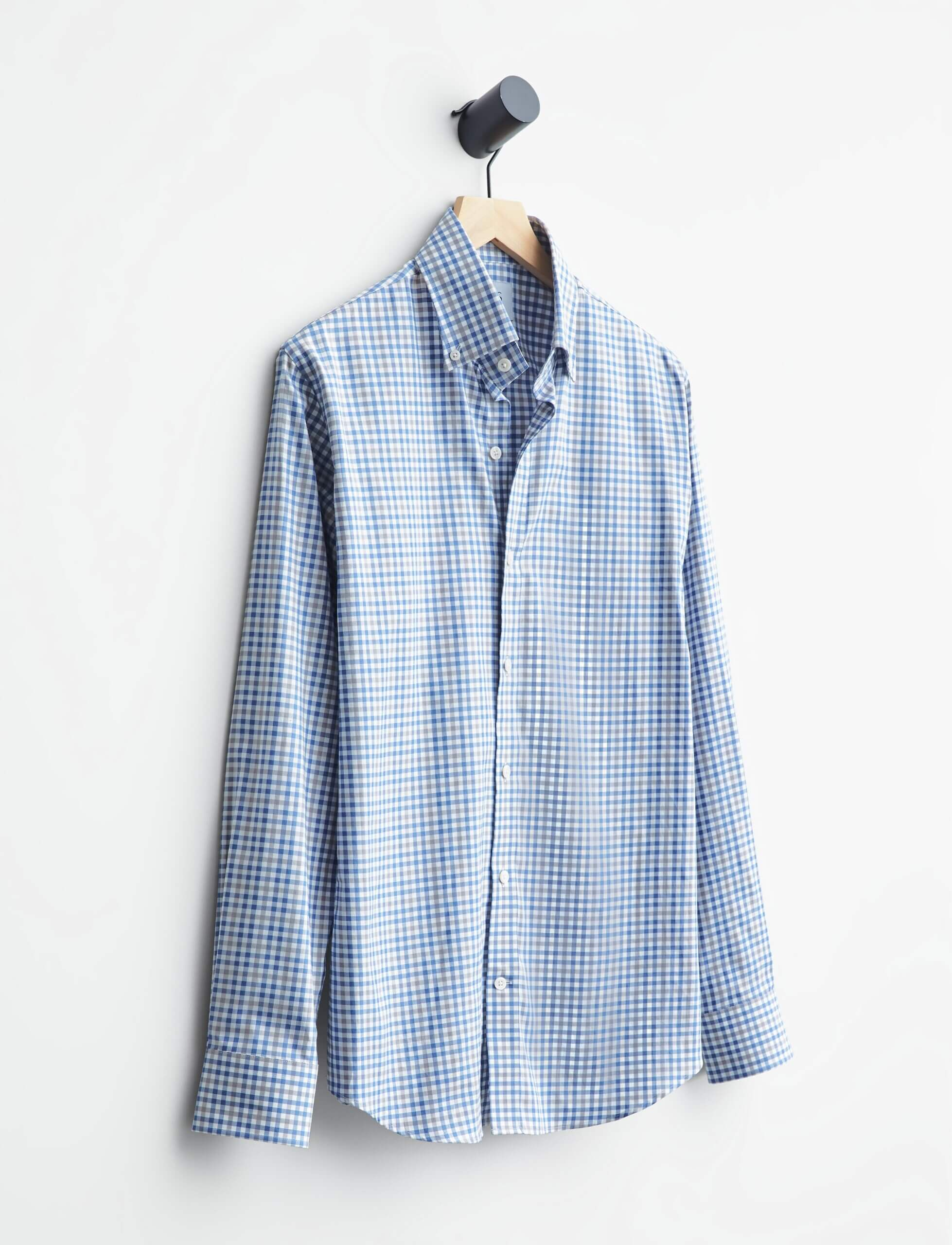 Stitch Fix men's plaid blue and white button-up hanging on a wood hanger.